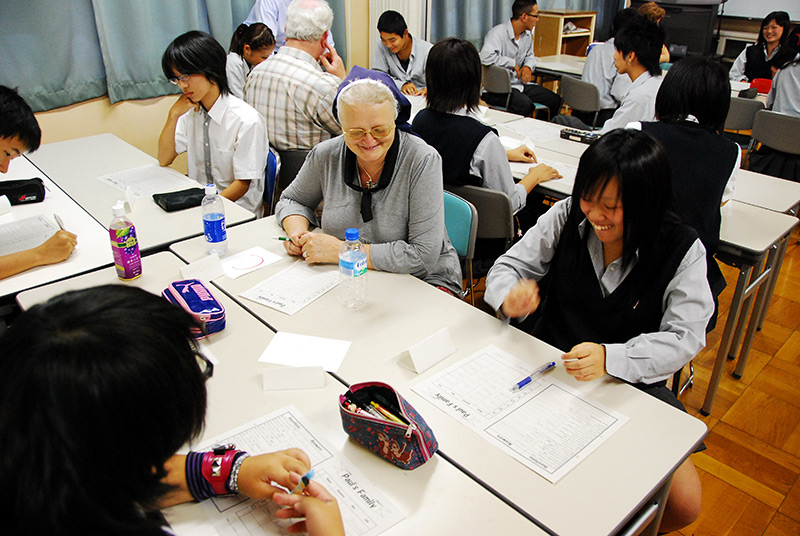 An elderly foreign woman teaching at Japanese night school