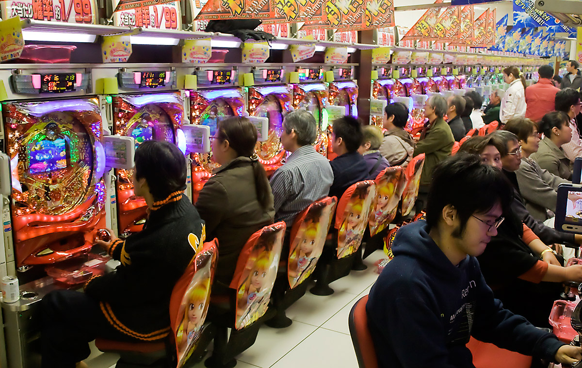 Japanese people playing in a pachinko parlor