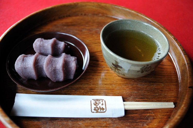 A cup of green tea and Japanese sweets with red bean paste