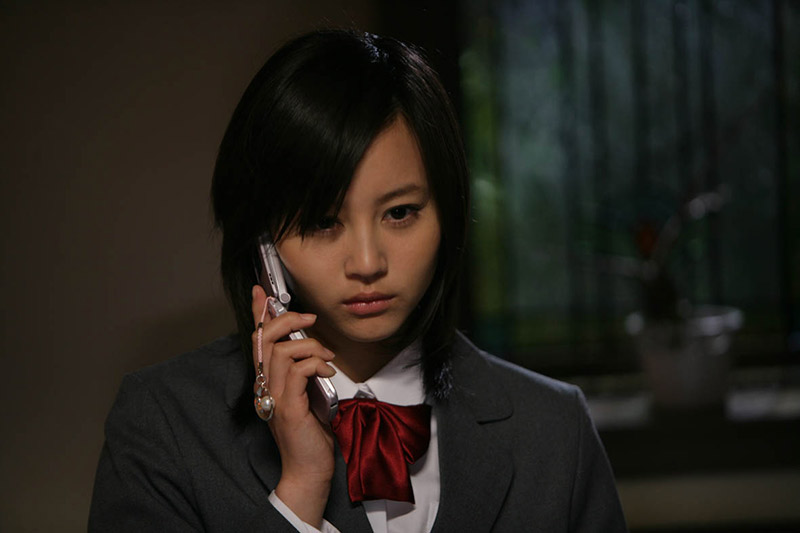 Japanese schoolgirl on cell phone