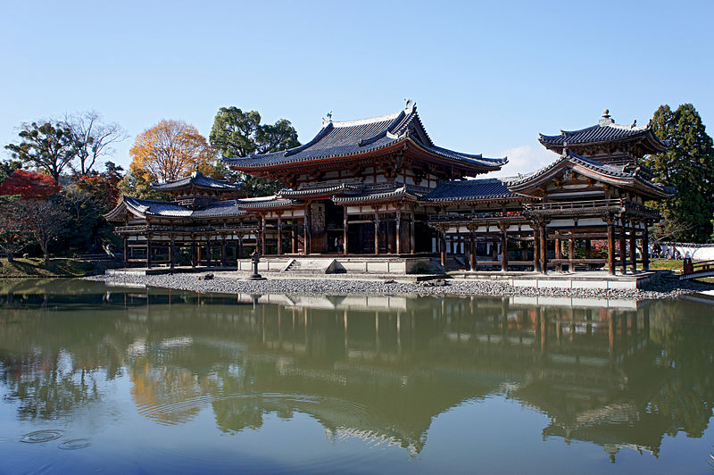 Temple with red columns and trim on a pond