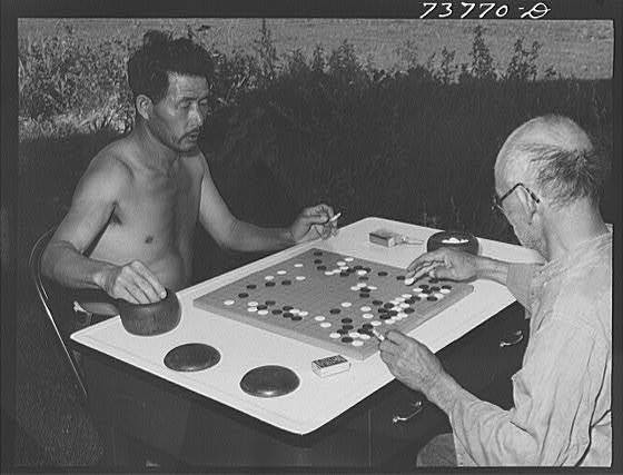 black & white photograph of men playing go