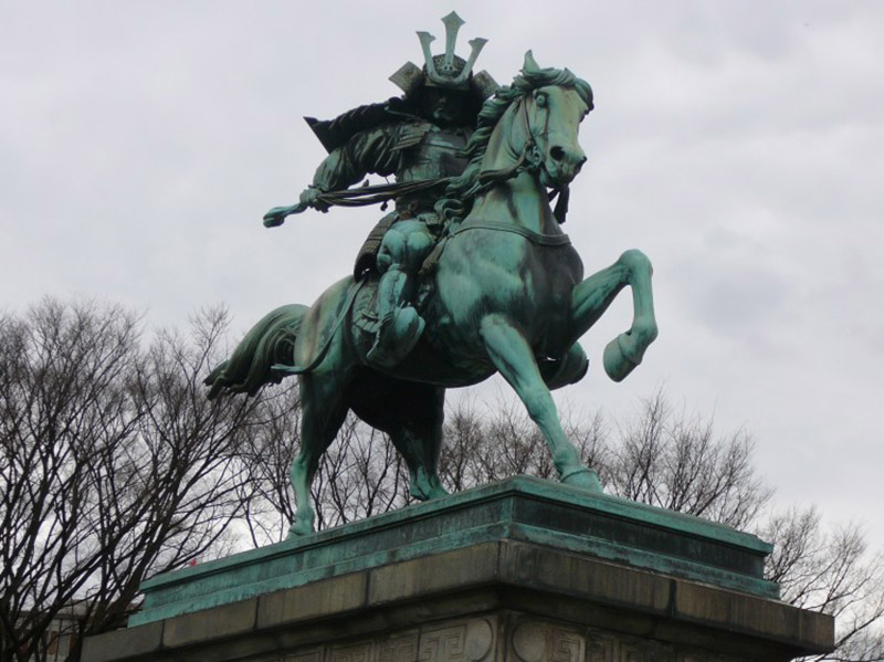 A statue of a mounted samurai