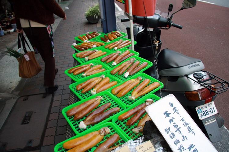 japanese food karasumi green trays on bikes