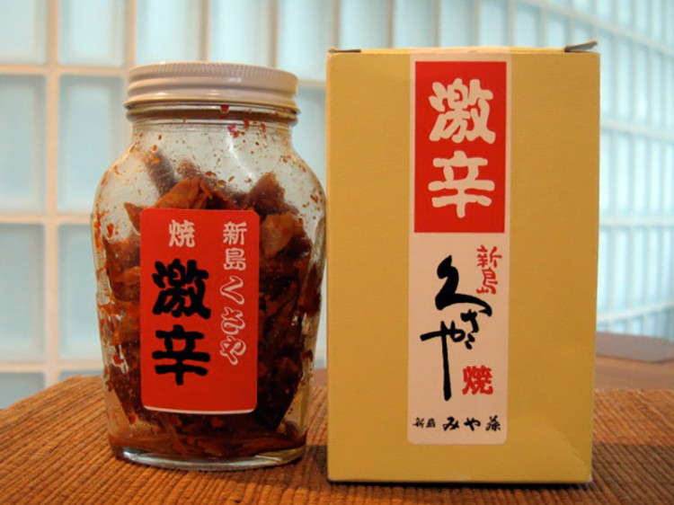 japanese spicy food bottle displayed next to box