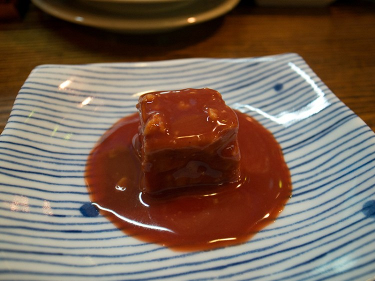 red tofu in sauce on blue and white plate