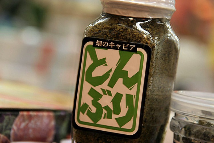bottle of green paste with japanese writing