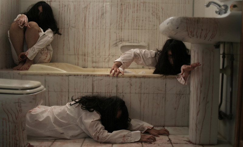 three scary japanese horror movie women in a bathroom