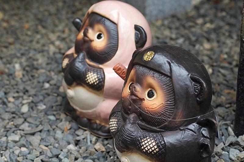 ninja tanuki statues