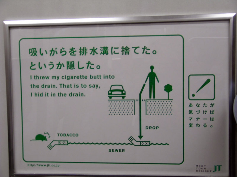 Sign reminding people not to throw away cigarettes in drains