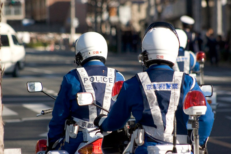 two police officers in japan riding motorcycles