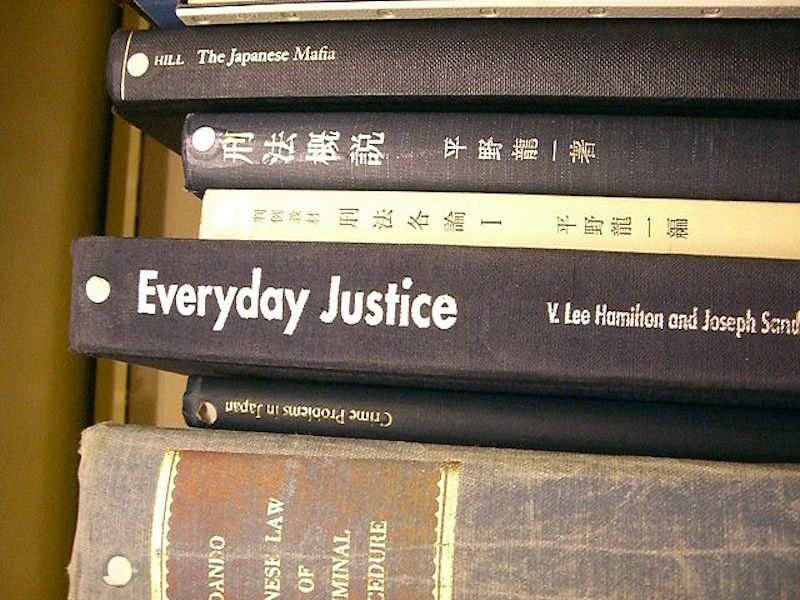 six books about japanese criminal law stacked together