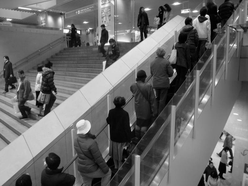 people on stairs and escalator