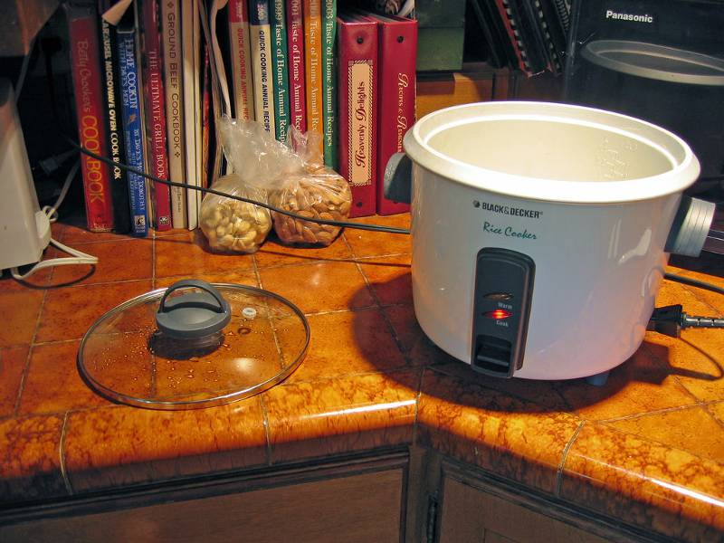 A rice cooker and some cookbooks
