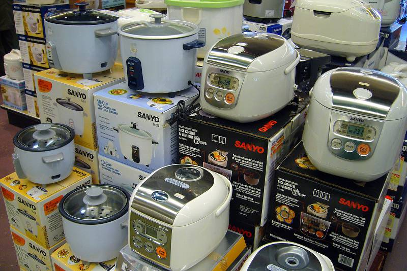 Stacks of rice cookers on display