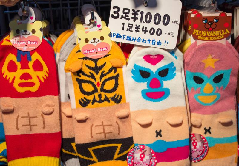 Luchador-printed socks with little arm nubs