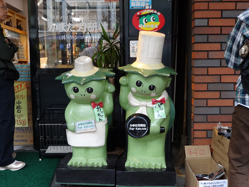 two cute welcoming kappa statues