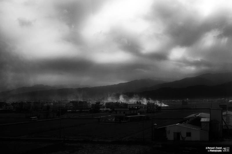 Black and white photo of a gloomy Japanese town