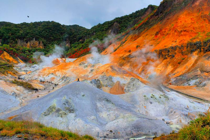 Steam emanating from the rocky terrain of Noboribetsu