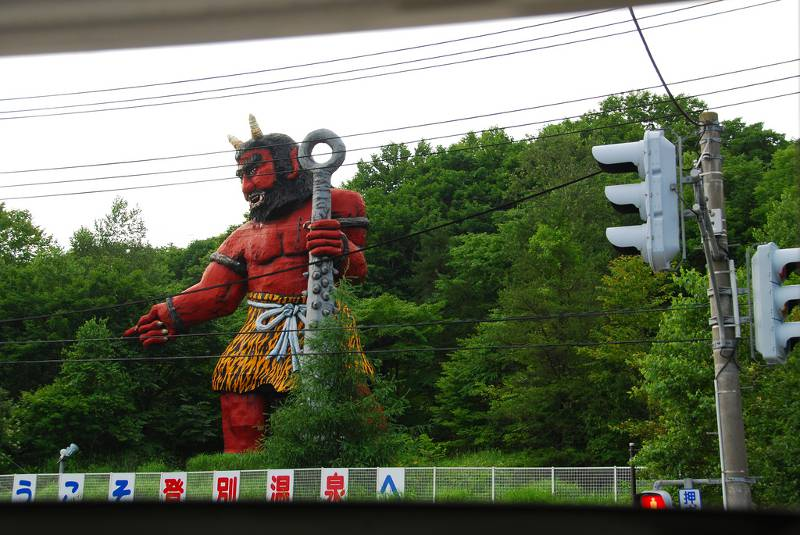 A large oni statue at a train station in Noboribetsu