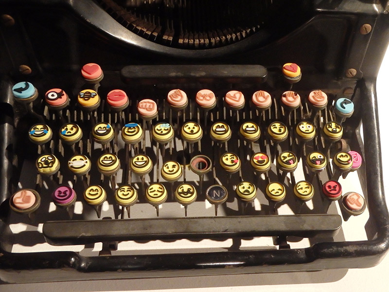 typewriter with emoji keys