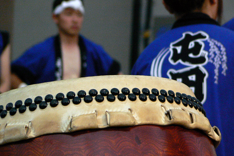 taiko drum with men in background