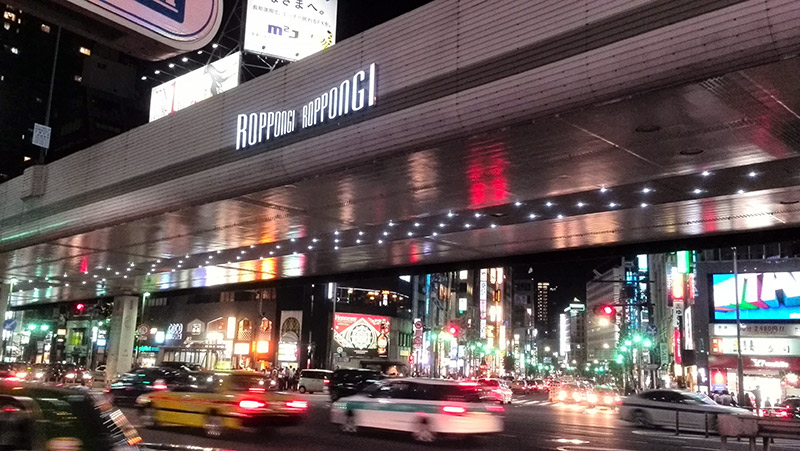 cars going through roppongi at night