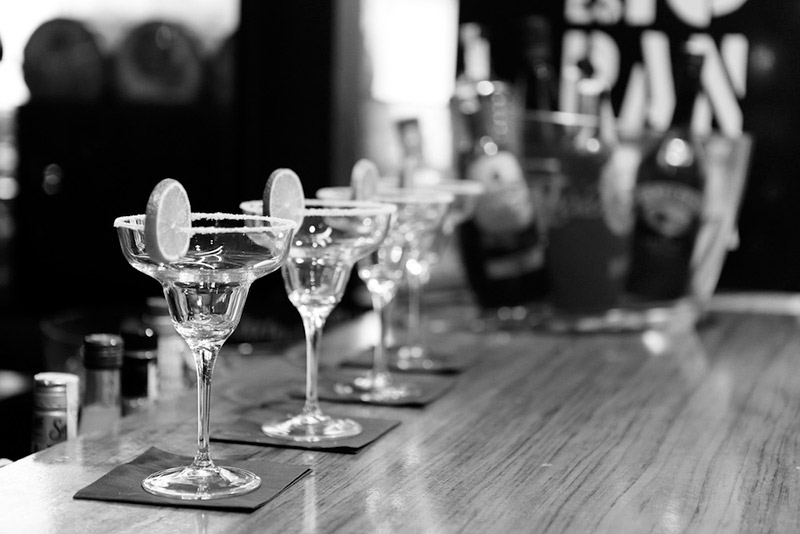 black & white photo of margarita glasses