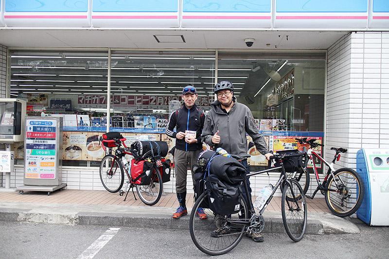 Men on a cycling trip in Japan take a break