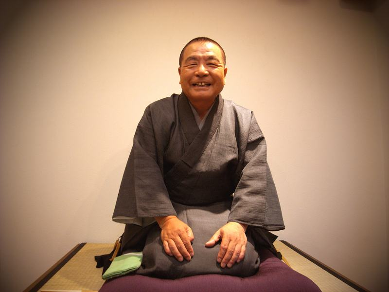 rakugo man sitting and smiling