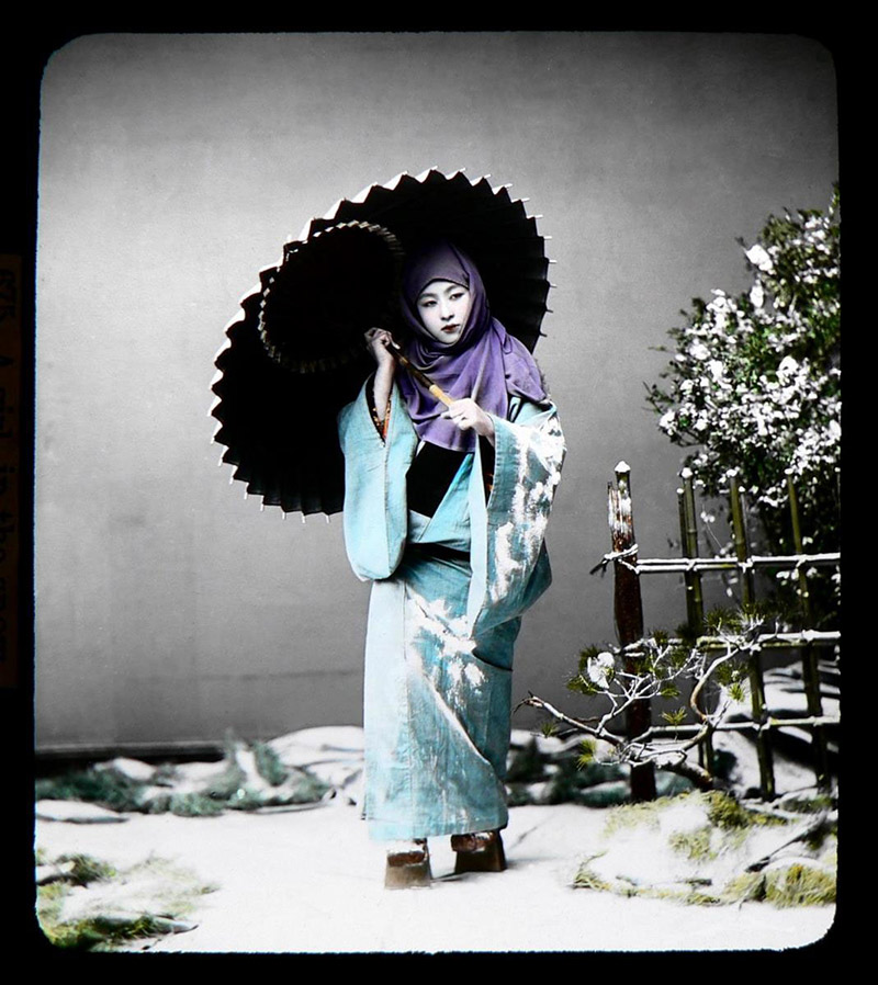 blue color girl in kimono in snow with umbrella