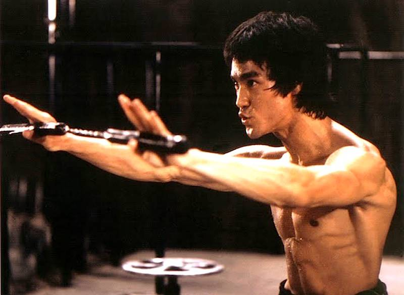 Bruce Lee uses nunchaku in the movie Enter The Dragon
