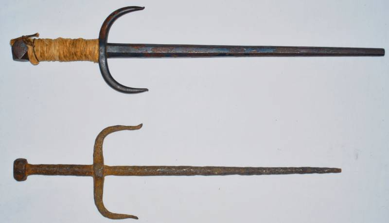 Image-of-two-rusty-Sai-an-ancient-three-pronged baton