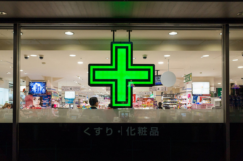 japan drug store window green cross