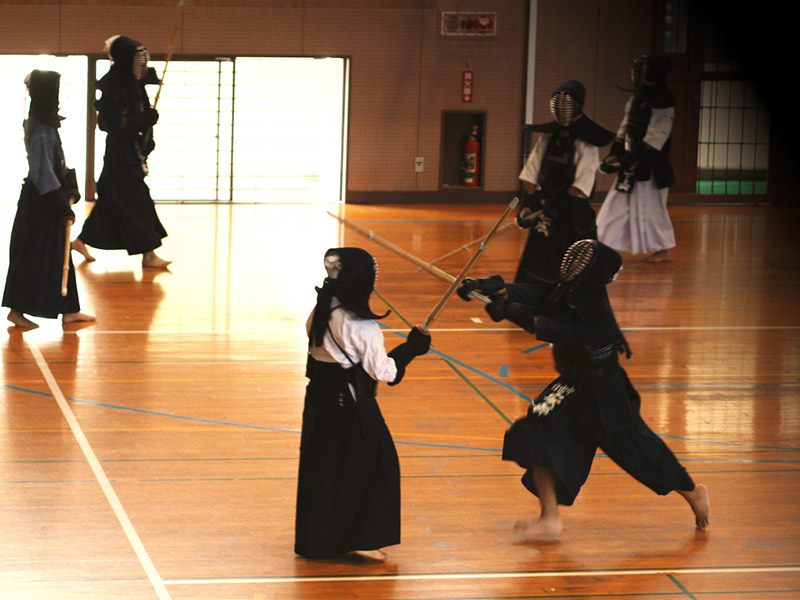 kids practicing kendo at a japanese school