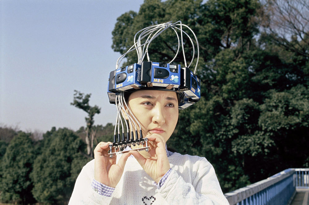 lady with disposable cameras on her head