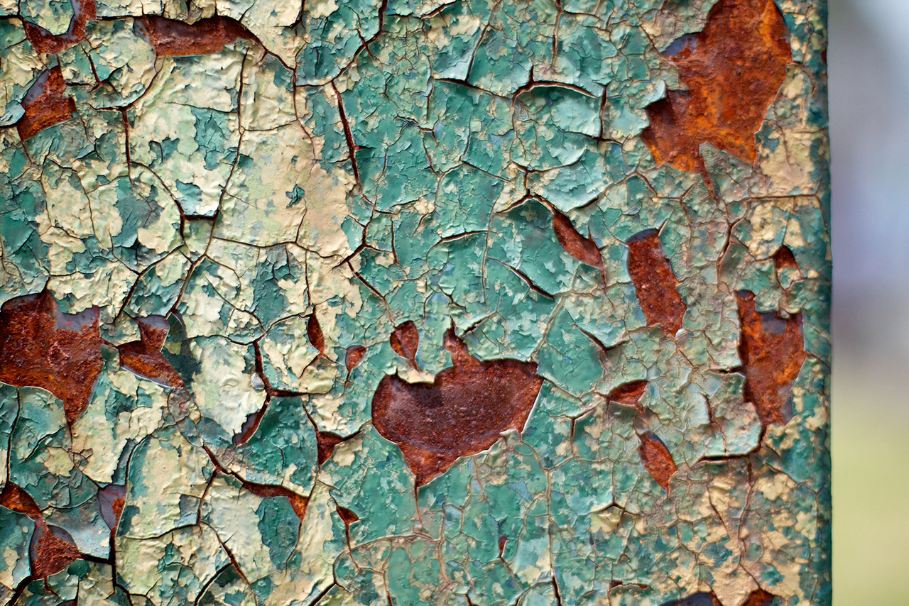 wabi-sabi green wall cracked with rust