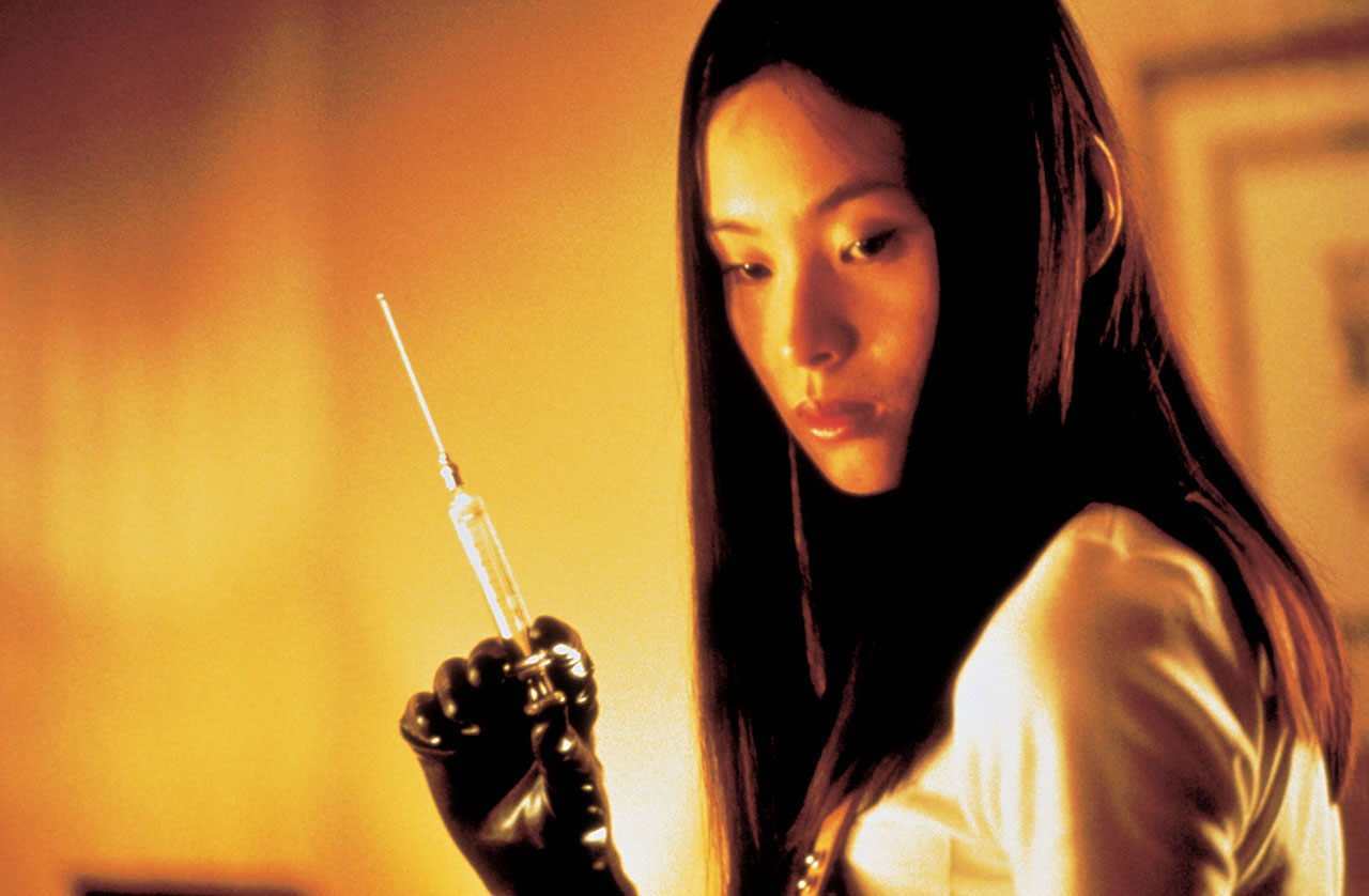 woman holding needle from japanese horror movie audition