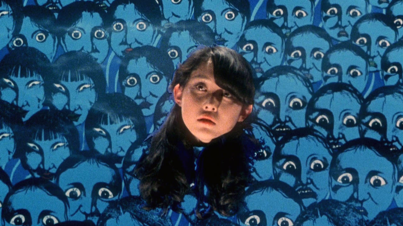 girl head floating among blue faces in hausu movie