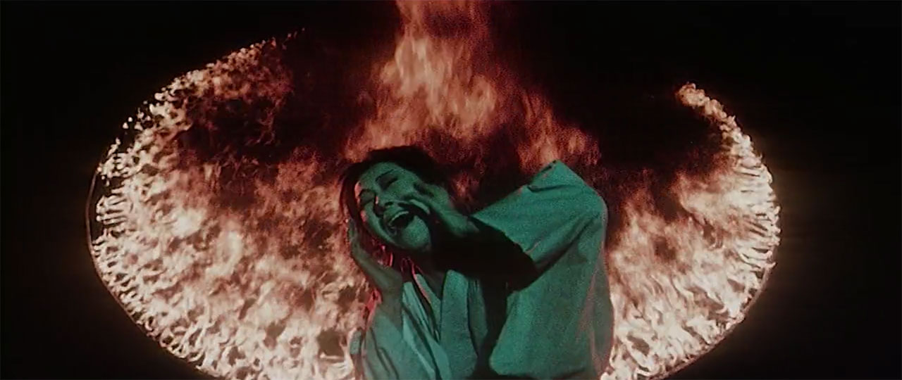 woman screaming in front of fire ring in jigoku