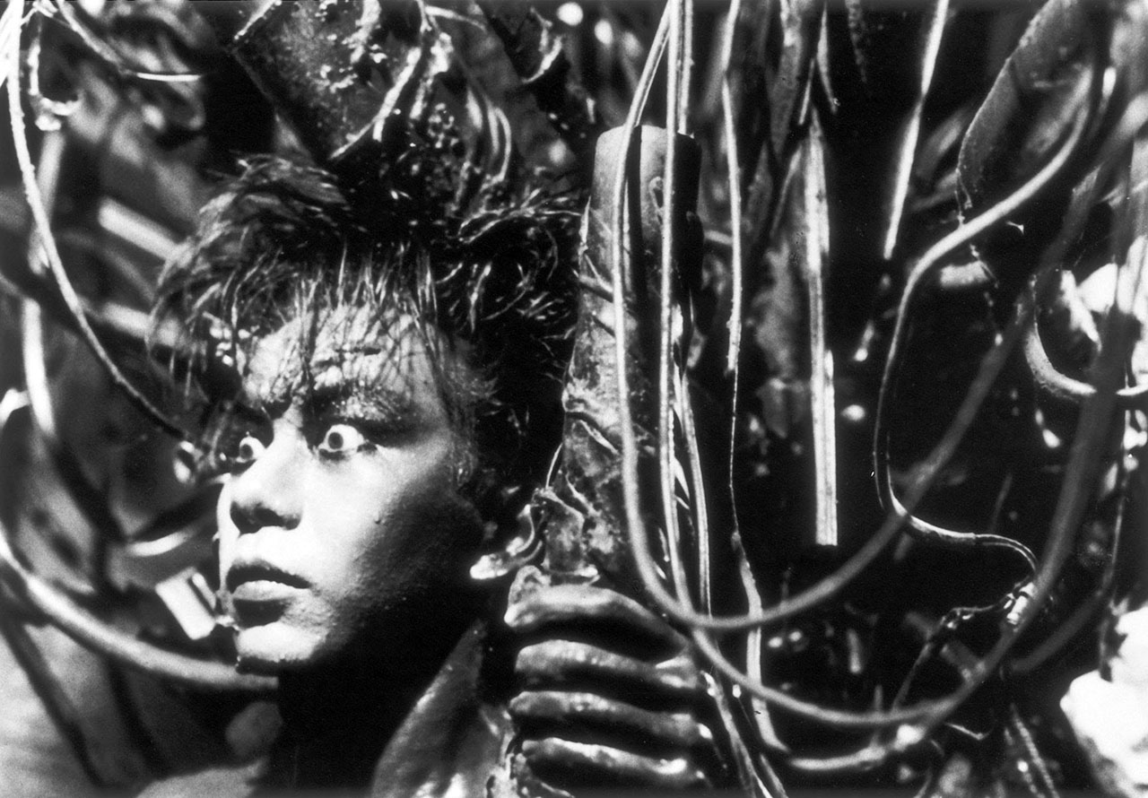 man covered in machinery from tetsuo the iron man