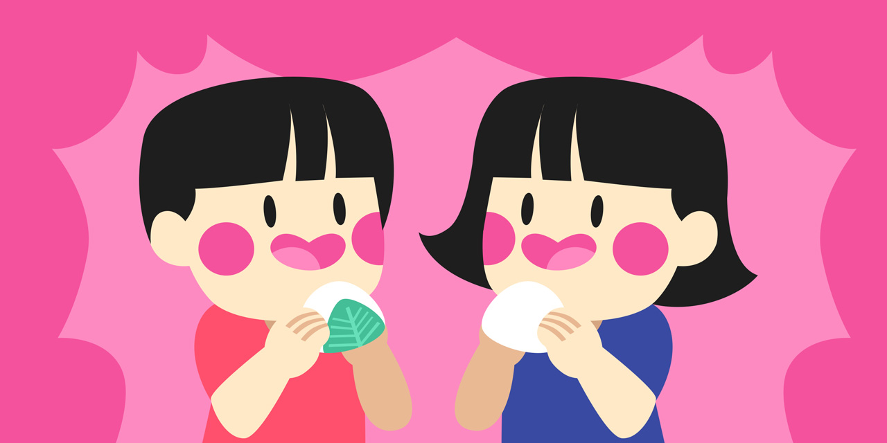 two kids eating mochi together