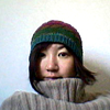 Japanese woman with a beanie and turtleneck