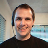 Man with a headset looking into camera