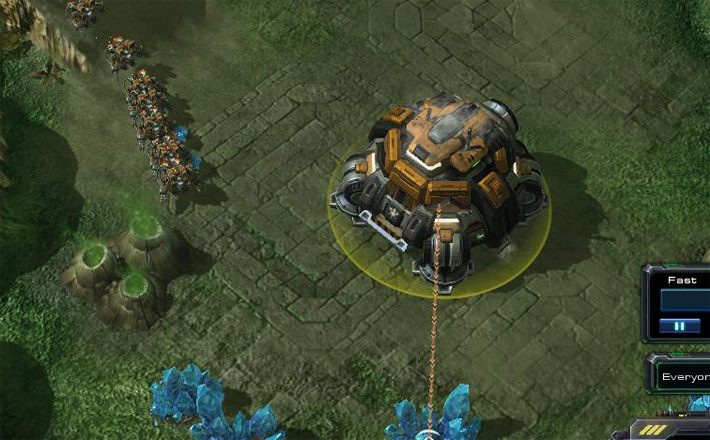 Starcraft 2's Orbital Japanese Learning Command building contemplating expansion