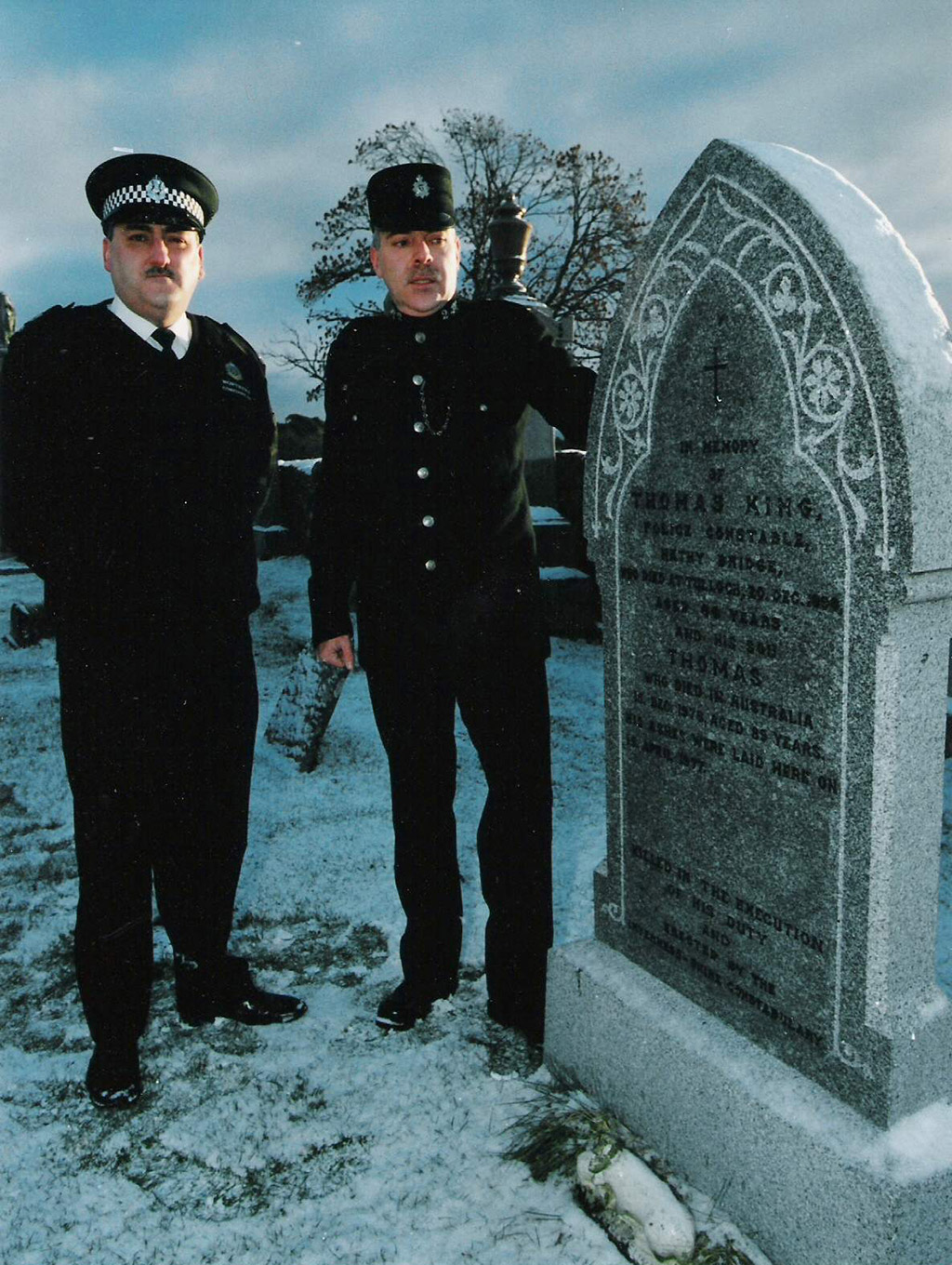 two british policeman by a gravestone