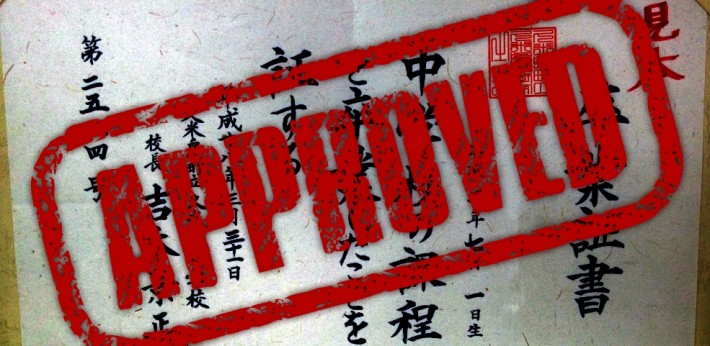 red approved stamp over top kanji
