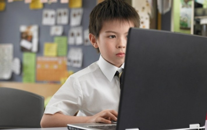 A young boy learning Japanese on his computer