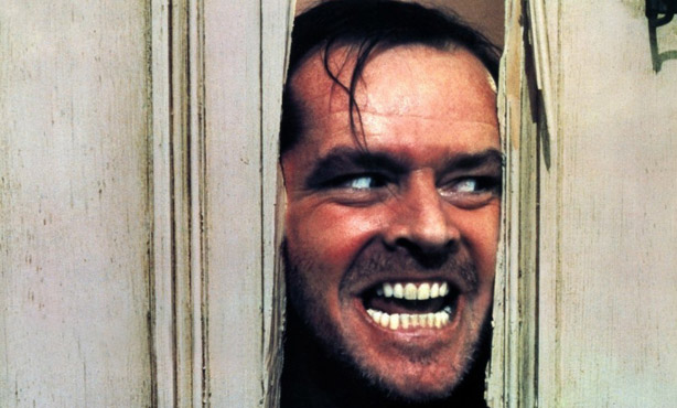 Jack Nicholson pearing through door from movie the Shining