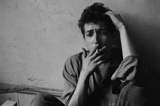 young Bob Dylan smoking a cigarette